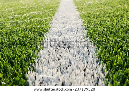Dew on  the artificial grass. - stock photo