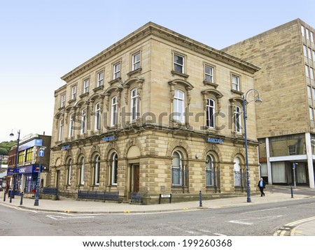 DEWSBURY, UK -JUNE 16: Bank, Dewsbury, West Yorkshire, England, UK, 16 June 2014. Dewsbury,  after a period of decline, is redeveloping  derelict mills into flats and regenerating city areas. - stock photo