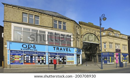 DEWSBURY, UK -JUNE 16: King's Arcade, Dewsbury, West Yorkshire, England, UK, 16 June 2014. Dewsbury, after a period of decline, is redeveloping derelict mills into flats and regenerating city areas.  - stock photo