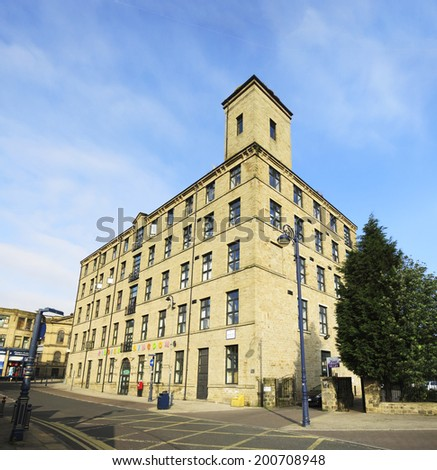 DEWSBURY, UK -JUNE 16: Recycled Mill, Dewsbury, West Yorkshire, England, UK, 16 June 2014. Dewsbury, after a period of decline, is redeveloping derelict mills into flats and regenerating city areas.  - stock photo