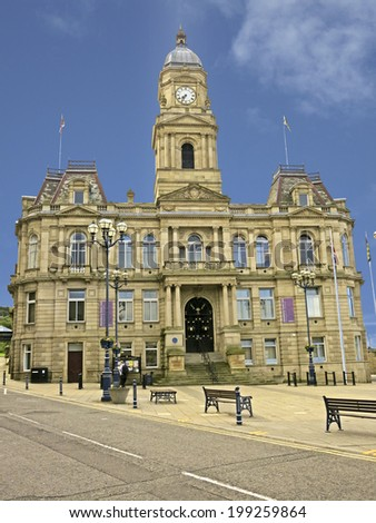 DEWSBURY, UK -JUNE 2014:Town Hall, Dewsbury, West Yorkshire, England, UK, 16 June 2014. Dewsbury,  after a period of decline, is redeveloping  derelict mills into flats and regenerating city areas. - stock photo