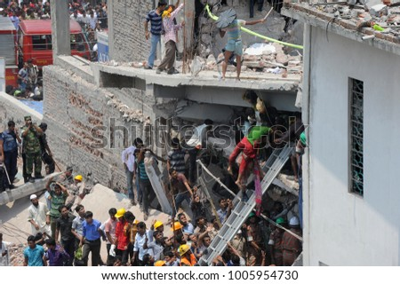 DHAKA, BANGLADESH - APRIL 24, 2013: Rescue workers try rescue trapped garment workers in the Rana plaza building which collapsed in Saver near Dhaka, Bangladesh on April 24, 2013.