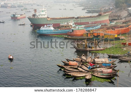DHAKA, BANGLADESH - DECEMBER 16, 2011: A view over a large number of boats and vessels on the riverside of the Buriganga.
