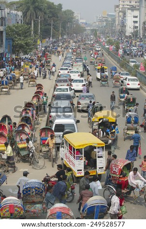 DHAKA, BANGLADESH - FEBRUARY 22, 2014: Busy traffic at the central part of the city in Dhaka, Bangladesh.