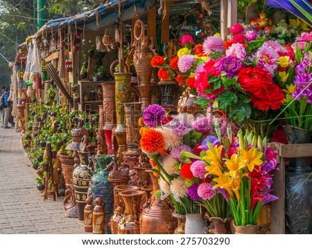DHAKA, BANGLADESH - JANUARY 13: Beautiful handmade showpieces in a road-side souvenir shop in Dhaka, Bangladesh on Jan 13, 2015. These shops sale handcrafts and showpieces to tourists and locals. - stock photo