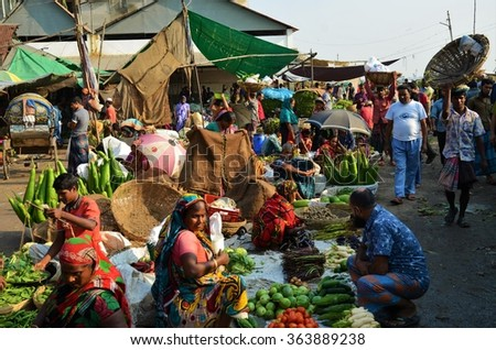 DHAKA, BANGLADESH - NOVEMBER 2: Locals are selling and buying fruits and vegetables at the food market on November, 2, 2014 in Dhaka, Bangladesh - stock photo
