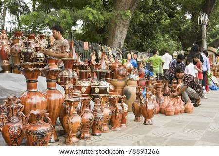DHAKA, BANGLADESH – SEPTEMBER 21: Clay-made pottery on display in a roadside handicraft shop on September 21, 2010 in Dhaka, Bangladesh. Shops like this sell handmade pottery to tourists and locals.