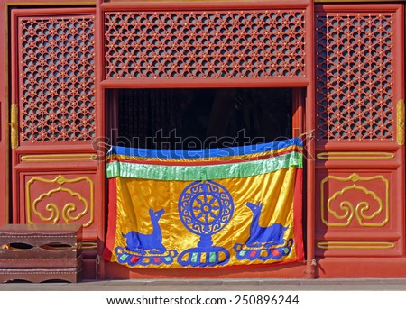 Dharma wheel and deer symbols of the Buddhist faith at Falun Hall,Yonghe (Lama) Temple in Beijing, China - stock photo