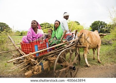 DHARNI, MAHARASHTRA, INDIA - JULY 9 :Unidentified  tribal  family in bullock cart at their village, , Dharni, Maharashtra,india,9 July 2015 - stock photo
