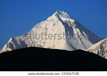 Dhaulagiri peak (8167 m) at sunrise. Nepal, Himalayas. Canon 5D. - stock photo