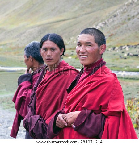 DHO TARAP, DOLPO, NEPAL - SEPTEMBER 11: Buddhist monks in national clothesl waiting for Puja ceremony during Full Moon festival on September 10, 2011 in Dho Tarap village, Nepal - stock photo