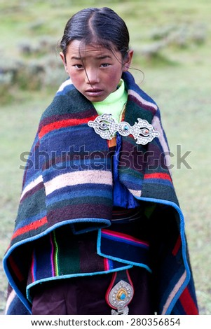 DHO TARAP, DOLPO, NEPAL - SEPTEMBER 11: Student of Crystal mountain school in national clothes poses for a photo during Dho Tarap Full Moon Festival on September 11, 2011 in Dho Tarap village, Nepal - stock photo