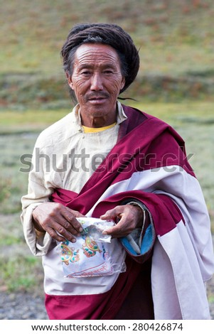 DHO TARAP, DOLPO, NEPAL - SEPTEMBER 11: Tibetan Ngakpa monk in traditional clothes poses for a photo during Dho Tarap Full Moon Festival on September 11, 2011 in Dho Tarap village, Nepal.  - stock photo