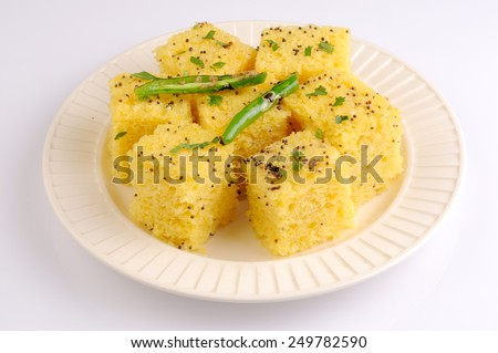 dhokla indian food,Gujarati Khaman Dhokla or Steamed Gram Flour Snack, Indian Food - stock photo