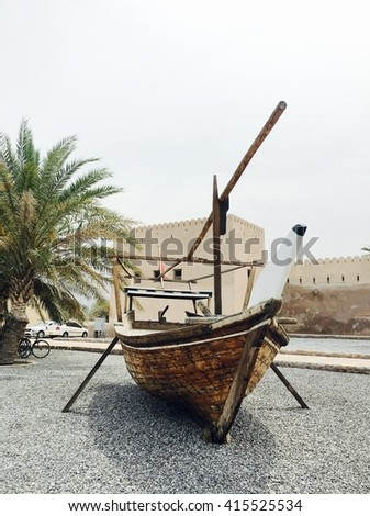 Dhow boat in front of Khasab castle, Musandam, Oman - stock photo
