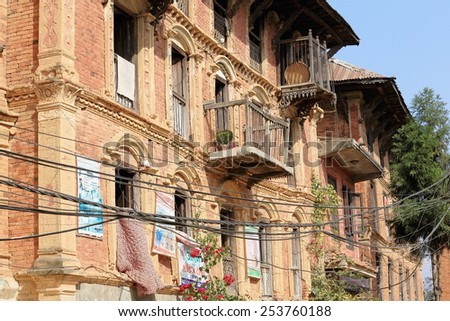 DHULIKHEL, NEPAL - OCTOBER 16: Traditional newar style houses show some ads on their red brick facades facing the old city area on October 16, 2012 in Dhulikhel-Kavrepalanchok dist.-Bagmati zone-Nepal
