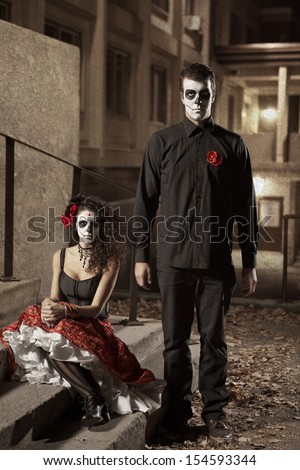 Dia de los Muerto Costume - Day of the dead is a mexican holiday. Here is a beautiful dead couple ! - stock photo