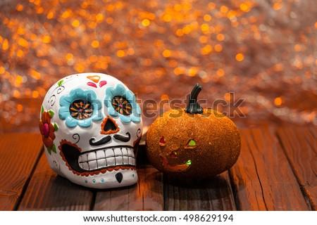 dia de los muertos halloween celebration background with sugar skull and orange pumpkin selective focus - Halloween Dia