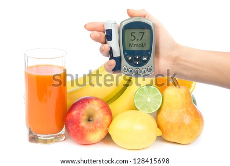 Diabetes concept glucose meter in hand and healthy organic food,  lemon, pear, apple, fresh orange, bananas and carrot juice on a white background