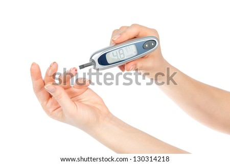 Diabetes concept. Measuring glucose level blood test using ultra mini glucometer and small drop of blood from finger and test strips isolated on a white background - stock photo
