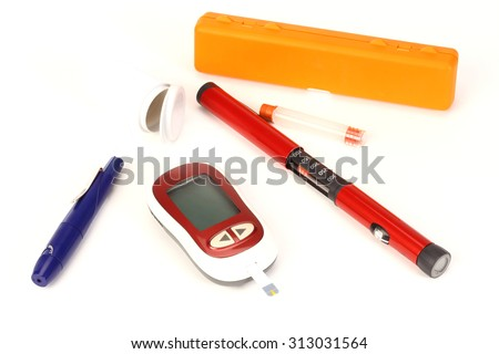 Diabetes equipment, Insulin pen and glucose level blood test - stock photo