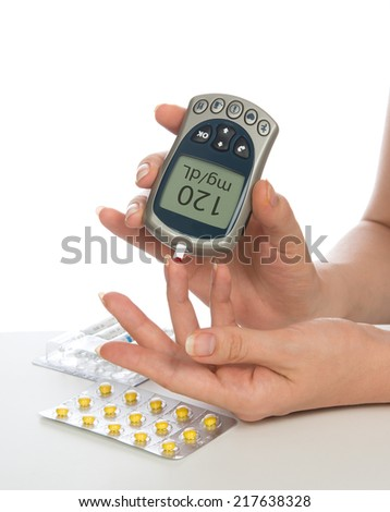 Diabetes patient measuring glucose level blood test isolated on a white background - stock photo