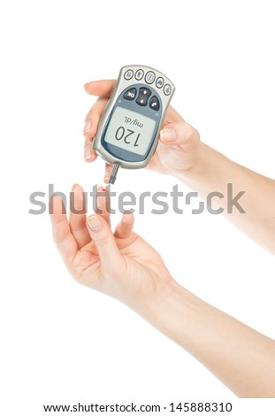 Diabetes patient measuring glucose level blood test using mini glucometer and small drop of blood from finger and test strips isolated on a white background - stock photo