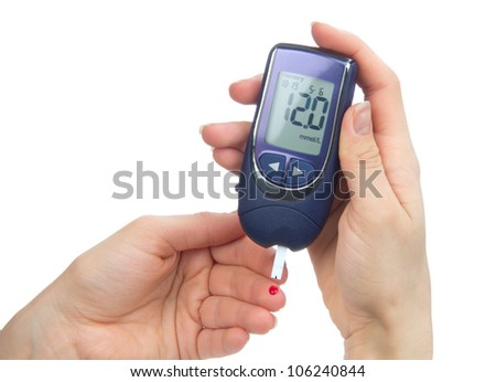 Diabetes patient poked finger to measure a glucose blood level test by new smart glucometer isolated on a white background - stock photo