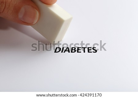 Diabetes word with eraser on white paper background - stock photo