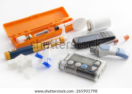 Diabetic items - all you need to control diabetes: - insulin pump for continuous feed -blood sugar meter - insulin pen - grucose injection (adrenalin)  - sugar - health food   - stock photo
