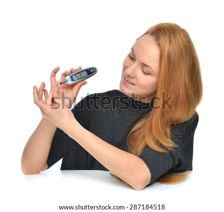 Diabetic patient measuring glucose level blood test using ultra mini glucometer and small drop of blood from finger and test strips isolated on a white background - stock photo