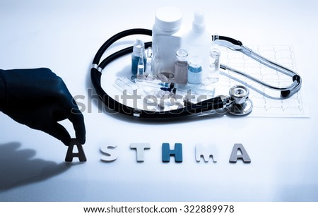 Diagnosis - Asthma. Medical concept with pills, injection, stethoscope, cardiogram and a syringe - stock photo
