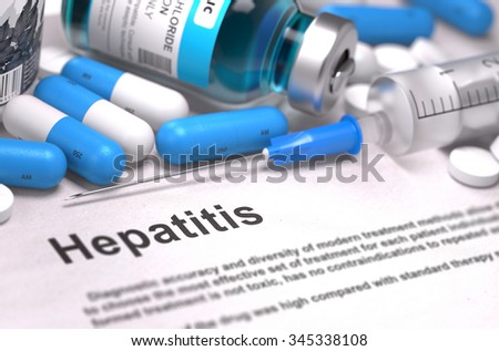 Diagnosis - Hepatitis. Medical Concept with Blue Pills, Injections and Syringe. Selective Focus. Blurred Background. - stock photo