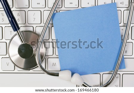 Diagnosis of Doctor - keyboard with stethoscope and blue note paper - free space for individual text - stock photo