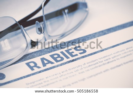 Diagnosis - Rabies. Medical Concept on Blue Background with Blurred Text and Specs. Selective Focus. 3D Rendering.
