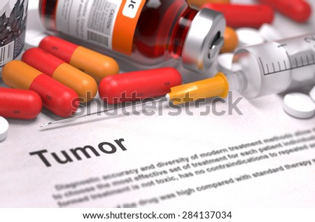 Diagnosis - Tumor. Medical Report with Composition of Medicaments - Red Pills, Injections and Syringe. Selective Focus. - stock photo