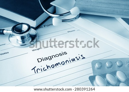 Diagnostic form with diagnosis Trichomoniasis and pills. - stock photo