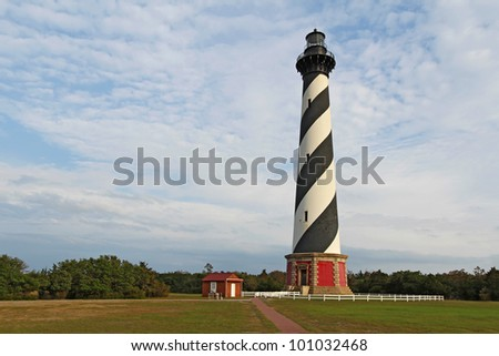 Diagonal black and white stripes mark the Cape Hatteras lighthouse at its new location near the town of Buxton on the Outer Banks of North Carolina - stock photo