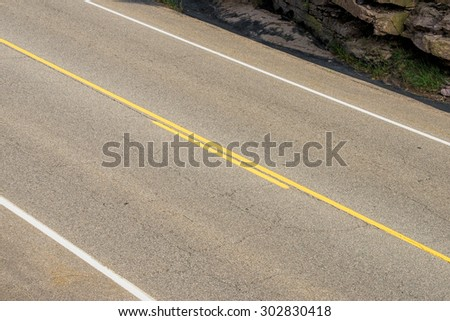 Diagonal image of a two-lane road - stock photo