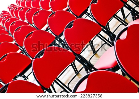 Diagonal picture of rows of red chairs  - stock photo