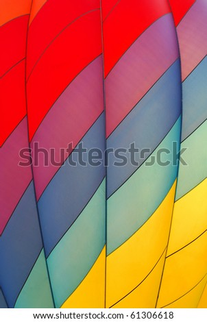 Diagonal rainbow pattern on a hot air balloon.
