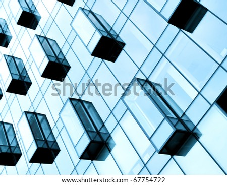 diagonal residential structure of high-rise glass apartment blocks - stock photo