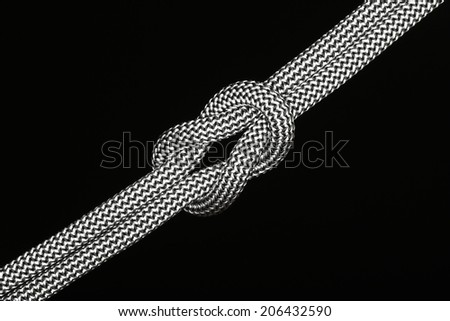 diagonal rope knot on black background close up