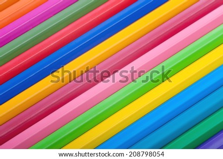 Diagonal row of colorful pencils, closeup - macro shot