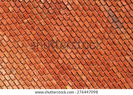 Diagonal rows of red bricks - abstract background - stock photo