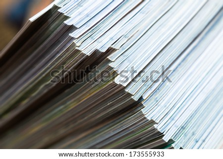diagonal view of a pile of magazines