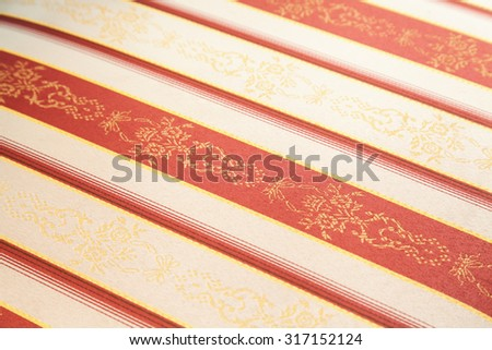 Diagonal vintage fabric textile with selective focus - stock photo