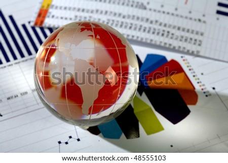Diagram and glassy globe.Finances concept - stock photo