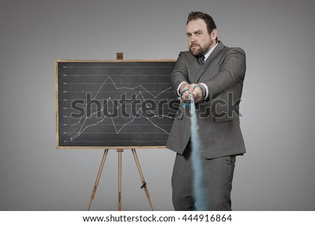 Diagram blackboard with businessman pulling rope at office