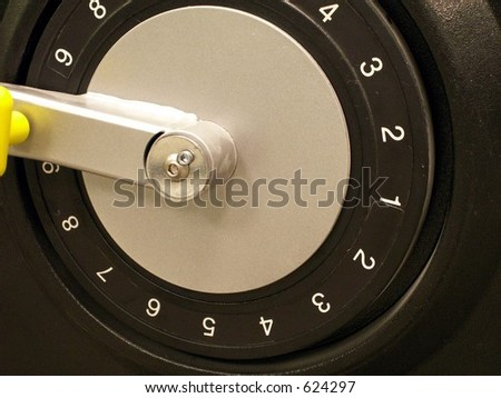 Dial for weight training machines. Taken close up of dial and handle used for changing weight to lift.